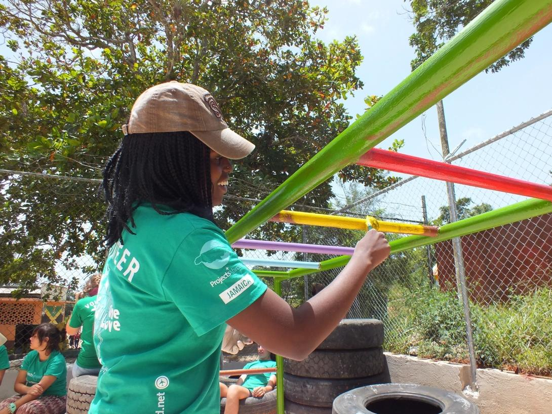 Volunteers put the finishing touches to a playground in Jamaica on a high school volunteer program.